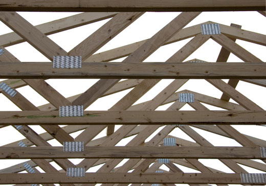 Prefab roofs wooden roof framing glulam prefab for Prefabricated wood trusses